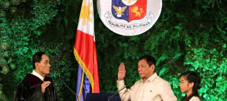 President Rodrigo Roa Duterte sworn in as 16th President by Supreme Court Justice Buenvenido L. Reyes, witnessed by the President's youngest daughter, Veronica Duterte, 30 June 2016