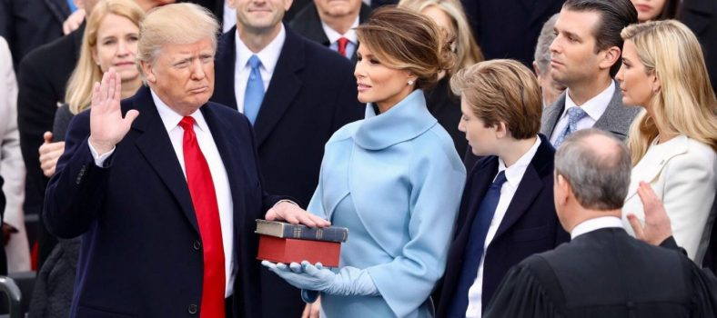 President Donald J. Trump is sworn-in by Chief Justice John Roberts as First Lady Melania Trump holds the bible, 20 January, U.S. Capitol Building, Washington DC.  Photo credit: White House Official Facebook Page