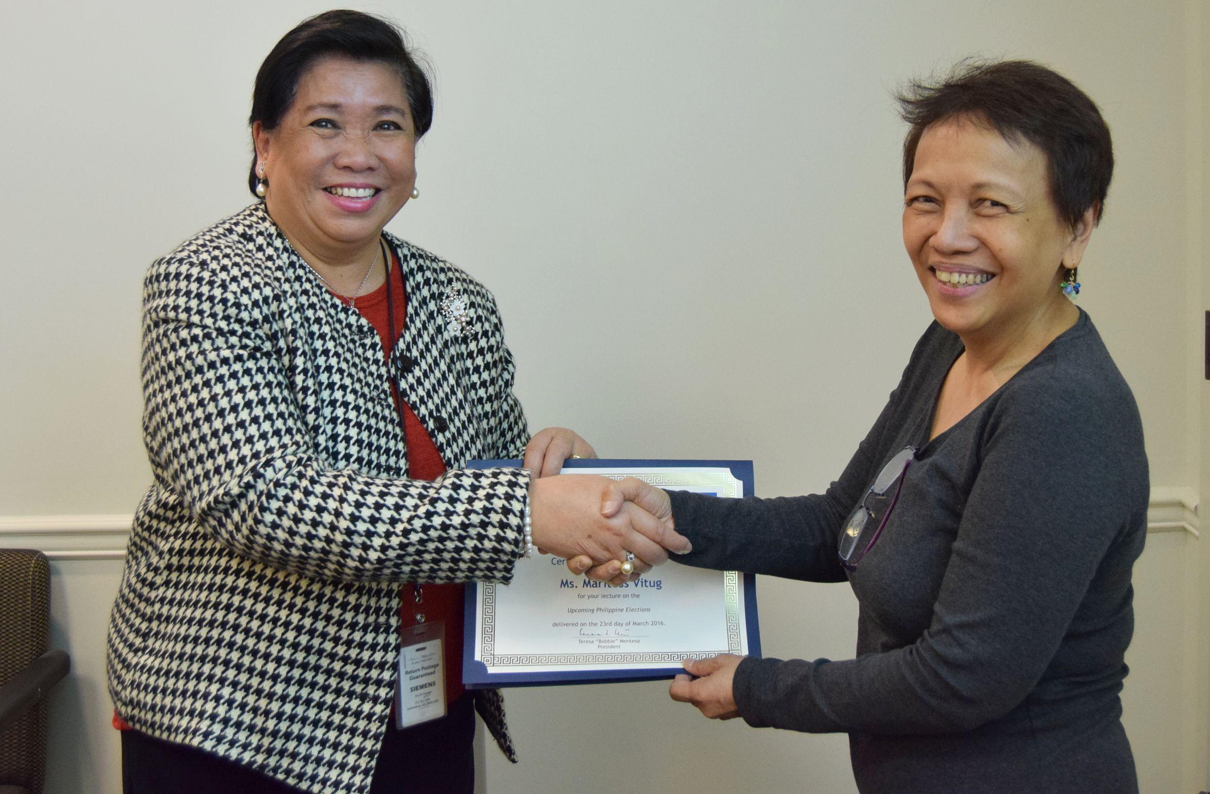 WBIFA President Teresa Montesa presents a Certificate of Appreciation to Marites Vitug